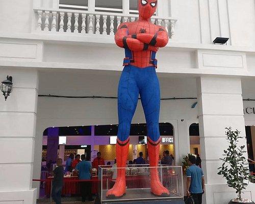 Spider Man welcoming the customer toward the cinema.