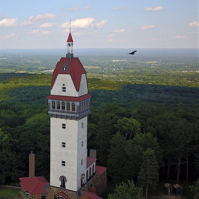 Aerial view of Heublein Tower, Hartford is visible in the background.