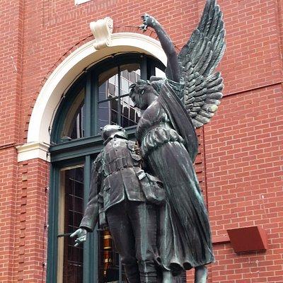 Angel carrying fallen soldier to heaven