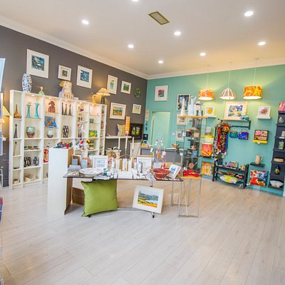 Lots of colour by local artists in ceramics, paintings, lighting and cards