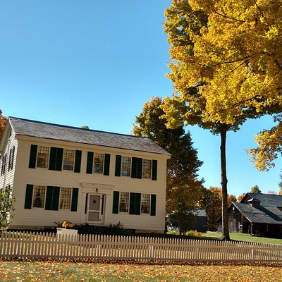 Fall foliage at the William Miller Home with barns in the background