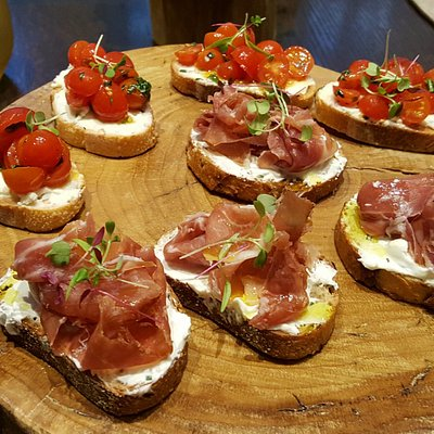 fresh cherry tomato and prosciutto toasts