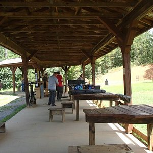 Covered concrete shooting pad with shooting benches.