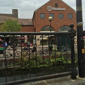Meadows Shopping Centre from the back by the river.