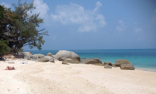 The small coral beach has little boulders you can snorkel around