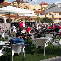 Enjoy our sunny terrace with a sangria, authentic tapas and let us make you happy.