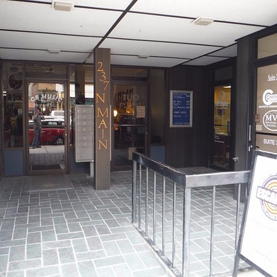Multiple businesses are located in this building. Escapade's door is to the right.