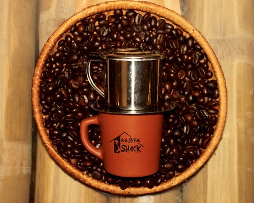 Vietnamese coffee filter on a Nguyen Shack coffee cup