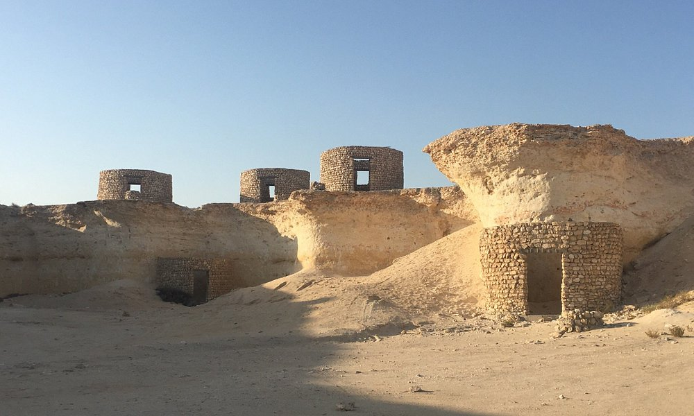 There is a place named Mystery Village, From Doha you take Dukhan road and near to Zeeket area y
