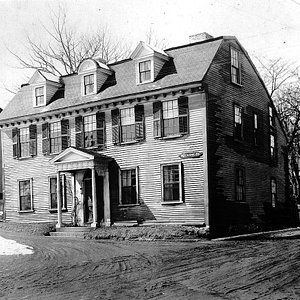 Old photo of the home in the early 1900s.  Dirt roads and prior to electricity.