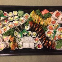 combination platter for 3-4 people, adjusted to add cucumber and avocado rolls