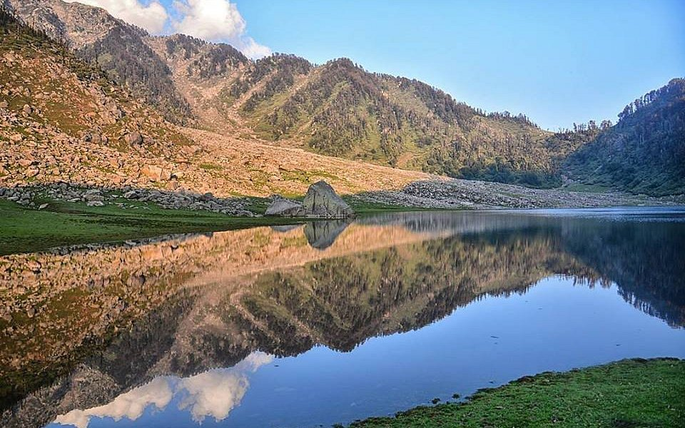 Kareri Lake is a beautiful lake lap of the Dhauladhar mountain range of Himachal Pradesh