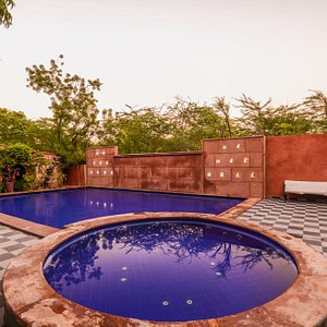 Swimming Pool with baby pool around Garden.