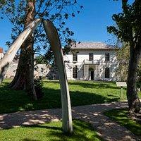 Castle Green House through the whale bone arch