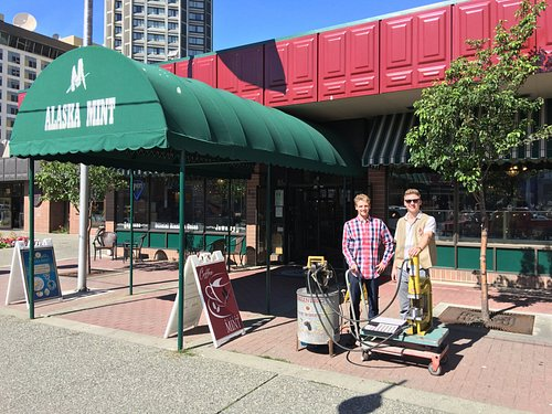 My sons outside the Mint demonstrating a portable coining press.