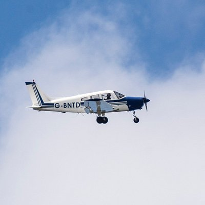 Our Piper Warrior aircraft in flight
