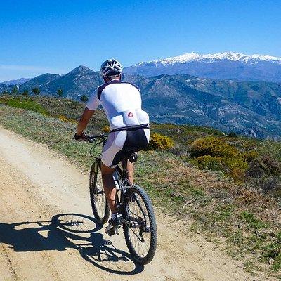 Mountain biking with Sierra Nevada in the background