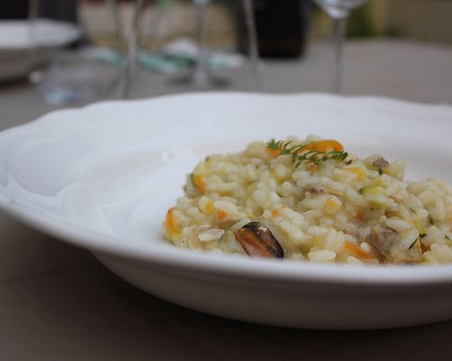Learn to make fresh seafood risotto with your host Gioia in Venice - Traveling Spoon