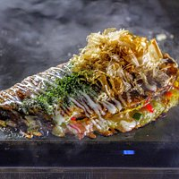 Our signature dish, Gion-yaki. It's beyond okonomiyaki. Outside is crispy, inside is creamy.