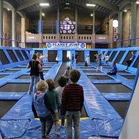 Children waiting to enter the tumbling trampoline lane at Planet Jump.