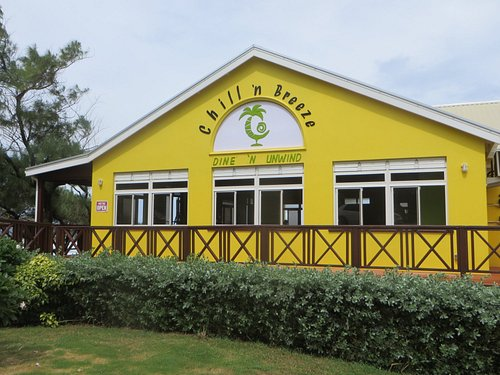 Bright yellow restaurant seen from the Ermy Bourne Highway; entrance to LHS