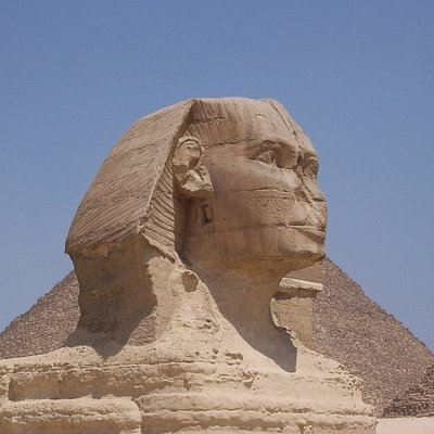 The Great Sphinx with pyramid behind.