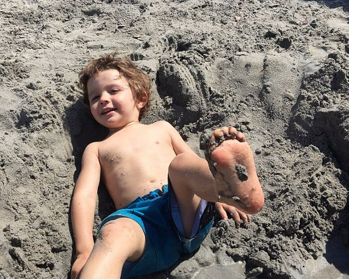 Young Pheonix playing in the sand by the lake