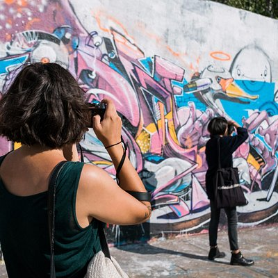 Snapping street art on our street photography tour.