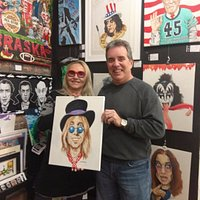 Artist Frank Costanzo and Vamplified artist Karen, getting ready for MusiCares silent auction