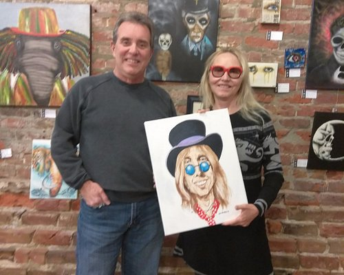 Artist Frank Costanzo and Vamplified holding Tom Petty painting. George Garrett art in backgroun