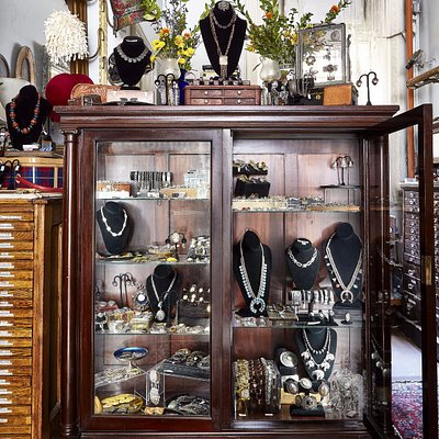 A case filled with Victorian, Art Deco, Midcentury, and Native American jewelry, cufflinks and b