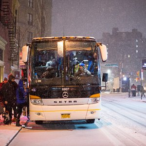 Bus picking up guests in the snow