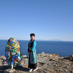 Girl in national buryat clothes on Khoboy Cape