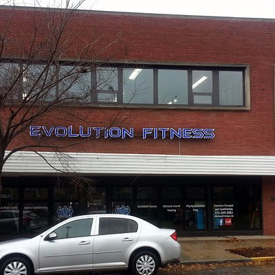 front of & entrance to Evolution Fitness