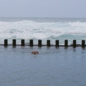 Swimming in calm water with waves so close makes for good experience