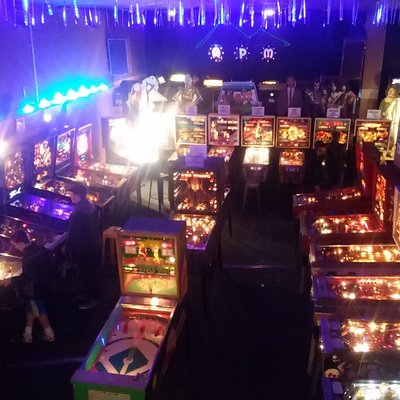 Pinball on the main floor and the Video games are on the raised stage.