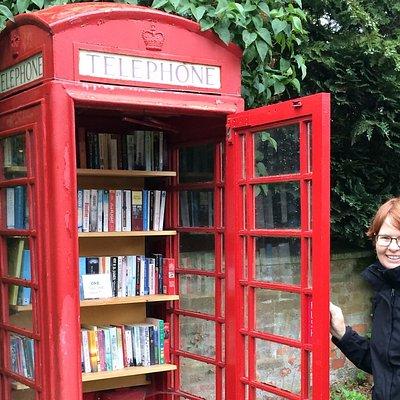 Bluestocking Books logo, red phonebox and books