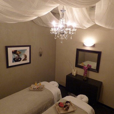 Enjoy a  relaxing couples massage in our chandelier suite!