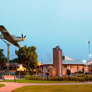 Griffith Visitor Centre on dusk, with the Fairey Firefly plane and Dethridge Wheel monument