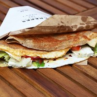 Savory galette with egg, goat cheese, spring onion, chilli and vegetable