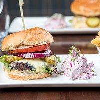 Porters 6oz Steak Burger Succulent Steak Burger topped with Smoked Applewood Cheddar, Dijon Mayo