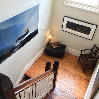 A Graeme Altmann oil painting in the stairwell.