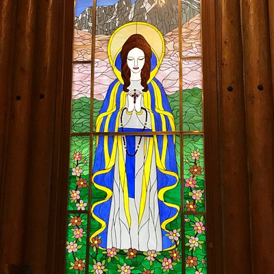 Large stained glass window in main chapel area