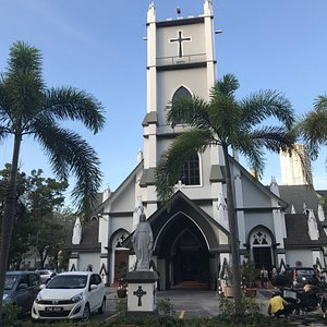 The facade and interior of Church of Immaculate Conception in Penang