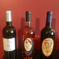 A Sauvignon Blanc, a Rose, a bold red. The label on the rose is a rendering of Elena's daughter.
