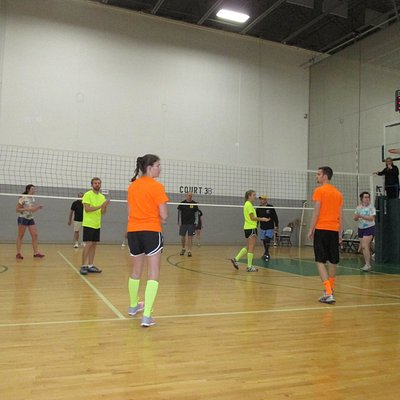 one of the basketball courts transformed into a volleyball court