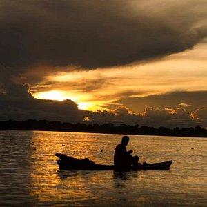 Tambopata river fishing boat at sunset