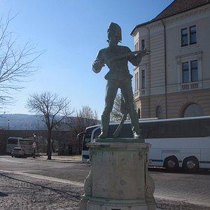 Statue of Oreg Huszar on Castle Hill, in front of Korona cukraszda