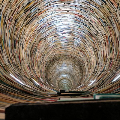 Inside the tower of books. The mirrors in floor and ceiling makes it look infinite.