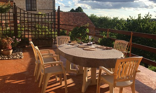 Dinner on the terrace, with its panoramic view of the surrounding woodland